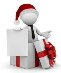 omino natalizio nel pacco regalo con foglio