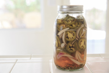 Jalapeno pepper red onion and garlic in a jar