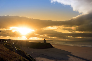 yellow sunshine over the Ballybunion beach and castle