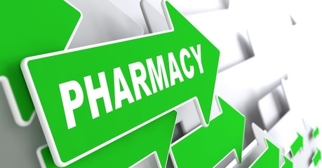 Pharmacy Branding on Green Direction Arrow Sign.