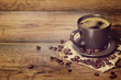 coffee served in a dark cup on wooden table on rustic style