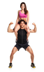 Sports guy holds on shoulder a girl on a white