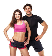 Athletic couple - man and woman after fitness exercise on white