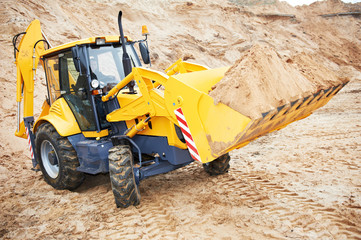 excavator loader at earth moving works