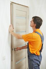 carpenter at door installation