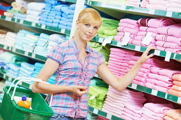 woman choosing textile linen in shop