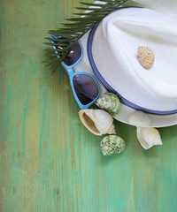 concept vacation, shells, sunglasses and a hat