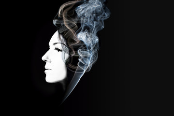Creative portrait of beautiful girl with smoke