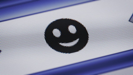 Smile icon on the screen. Looping.