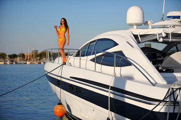 Summertime sailing vacation, swimsuit model outdoor.