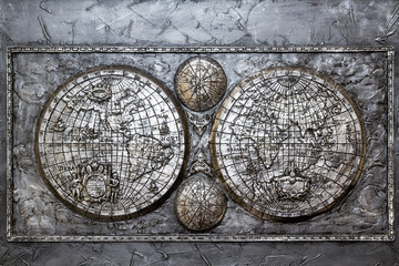 The ancient metallic plaque depict the map of the world
