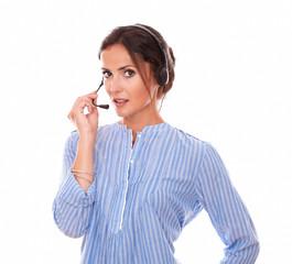 Charming female operator speaking with earphone