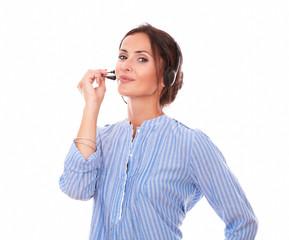 Sexy operator lady speaking on headphones