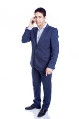 Full body portrait of a businessman on the phone, isolated on wh