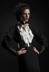 Fashion shot of a woman in a strict black suit