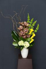 Floral arangement with Calla, cymbidium, Hydrangea, moluccella
