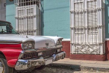 Red and white old american car in Trinidad, Cuba