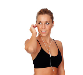 Pretty woman doing fitness istening music with headphones