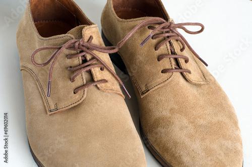 Leinwandbild Motiv Brown Suede Leather Shoes on White