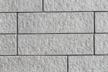 texture of rough grey tile wall