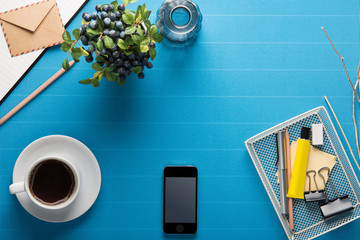 Office workplace,office Equipment and coffee break on blue crepe