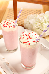 Delicious milkshake on table