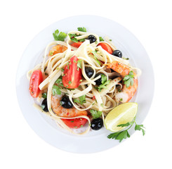 Fresh prawns with spaghetti, olives, tomatoes and parsley in a