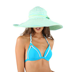 Beautiful young woman in swimsuit and hat isolated on white