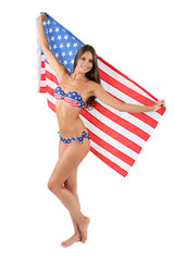 Beautiful young woman in swimsuit with with American flag