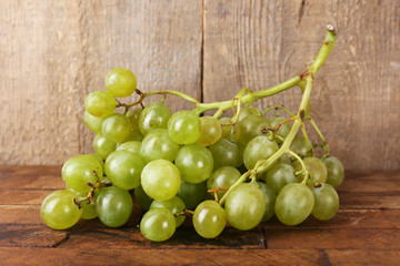 Green grape on wooden background