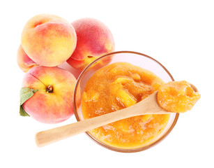 tasty peach jam with fresh peaches, isolated on white