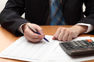 Businessman viewing financial statements