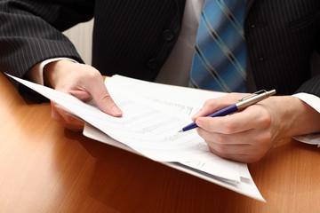 Businessman viewing financial statements