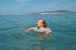 ittle girl on the beach.