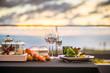 Leinwanddruck Bild - Empty glasses set in restaurant  Dinner table at sunset