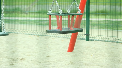 Empty swing on playground. Full HD with motorized slider. 1080p.