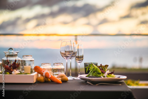 Empty glasses set in restaurant  Dinner table at sunset