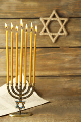 Menorah on wooden background