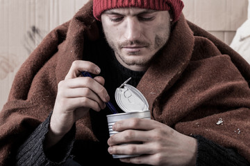Frozen homeless man eat