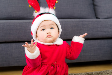 Asian baby girl with christmas dressing