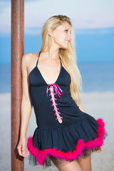 Sexy blond woman in black peignoir