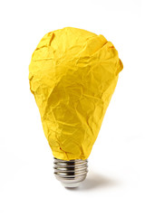 Bright idea - yellow crumpled paper lightbulb - isolated
