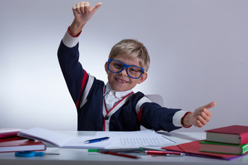 Young pupil showing okay gesture