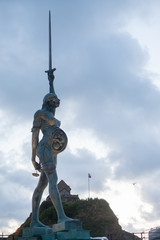 View of Damien Hirst's Verity at Ilfracombe harbour in Devon