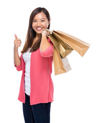 Happy woman with shopping bag and thumb up