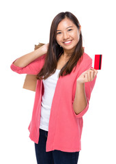 Young woman with shopping bag and credit card
