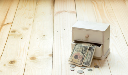 Money box on yellow wooden background