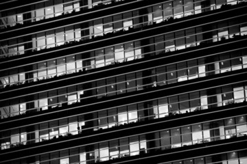 Office windows in the night. Black and white version
