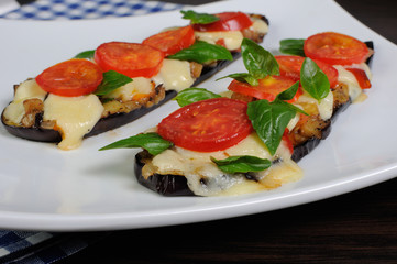 Baked eggplant with tomato and basil and cheese