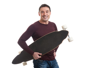 Happy smiling man holding longboard in his hand